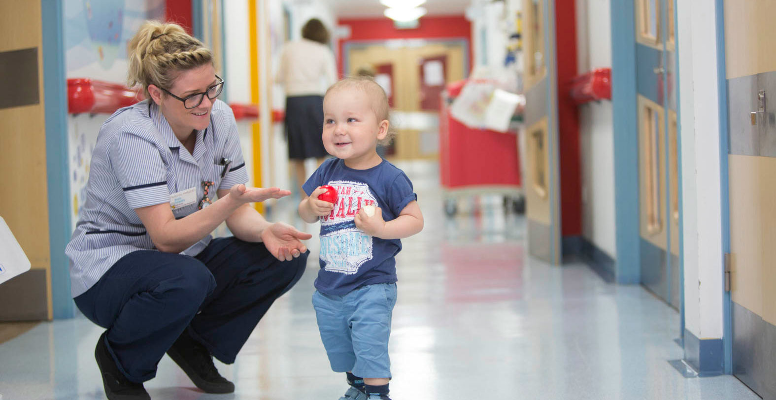A young patient playing with Staff Nurse