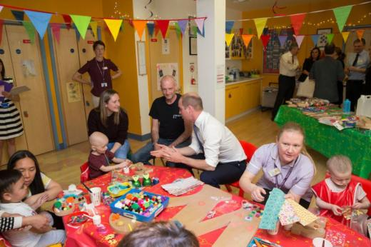 HRH The Duke of Cambridge talks to parents of a patient in one of our play areas