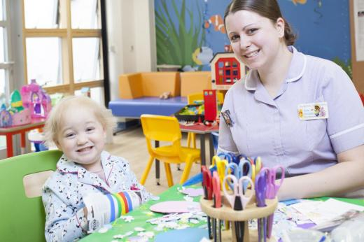 Play specialist Kate Hodgkiss in the playroom with young patient Filly Hookway