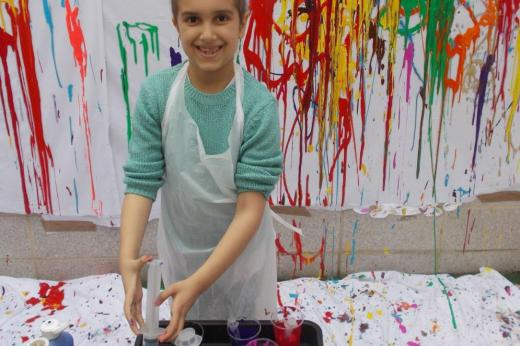 Young patient plays with paint syringes
