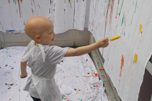 Patient playing with paint syringe
