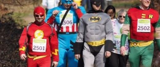 Marsden March participants dressed as superheroes - The Flash, Batman, Robin and Captain America