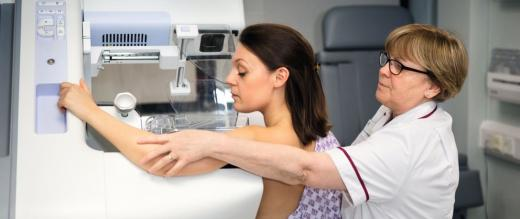Nurse helping woman with mammogram