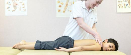 Boy gets physiotherapy massage