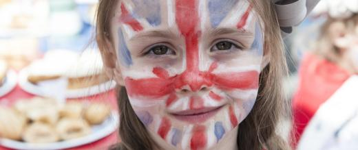 Girl with union jack painted on her face