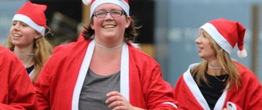 Participants in their Santa outfits