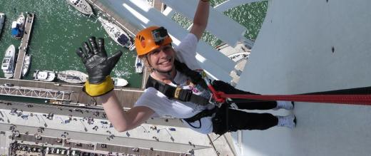 One of our supporters waves as she abseils down the Spinnaker Tower