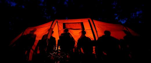 People in tent at night