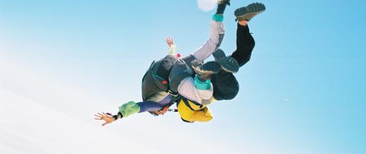 Two people joined together skydiving