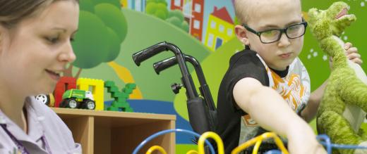 Jack and play specialist Kate Hodgkiss in the Radiotherapy playroom