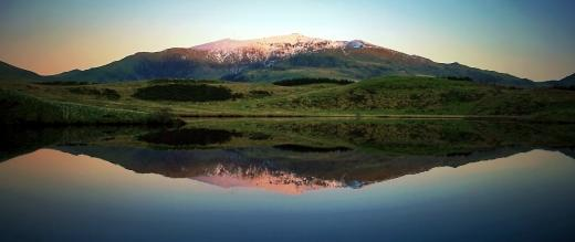 Dawn at Mount Snowdon shown reflected in a lake