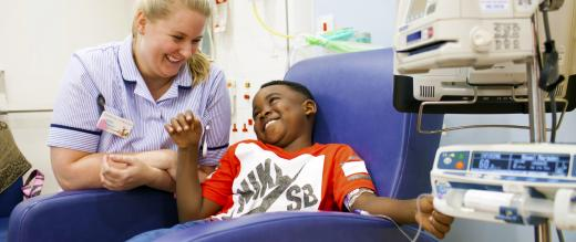 Play specialist India Nelson with a patient