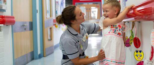 Patient Elodie Macey with a nurse
