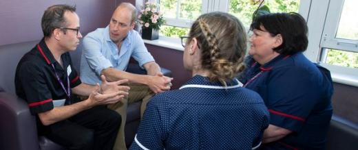 Staff who received psychological support meet with The Duke