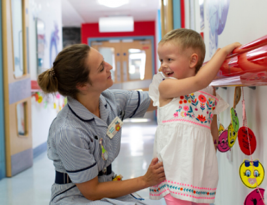 Nurse in hall with a child patient