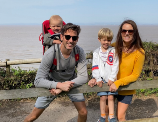 Image of Natalie enjoying a day out with her husband and two sons.